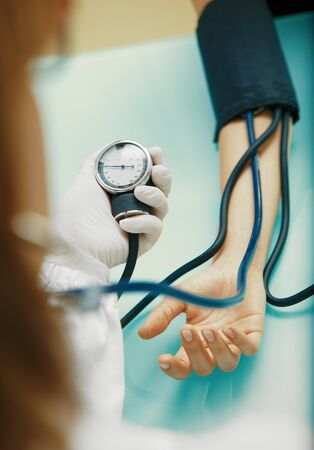 Patient is being observed by doctor - blood pressure