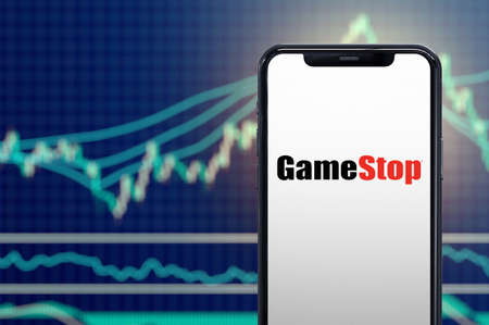 Milan, Italy: February 26, 2021: Gamestop retail company logo on the smartphone and its authentic stock price chart for the last 5 days. 3d rendering