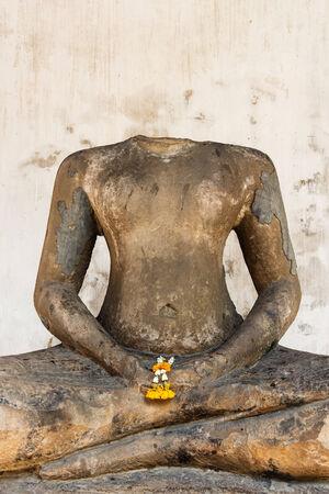 image of headless buddha due to damaged ,Thailand photo