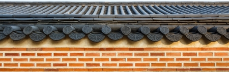 roof on wall in Gyeongbokgung palace ,Korea