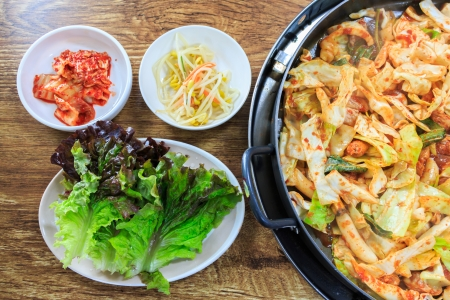 Korean food compose of kimchi,fresh lettuce, bean sprouts and stir-fried vegetables with chicken on wood table Stock Photo - 24035859