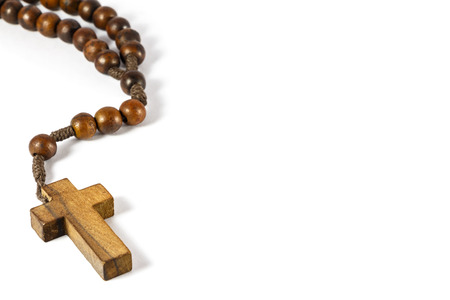 wood rosary with cross at left border and blank area at right side  white background