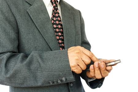old aged thai businessman is playing mobile and blank area at right side on white background isolated  photo