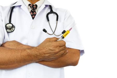 asian doctor is holding syringe on white background and blank area at right side photo