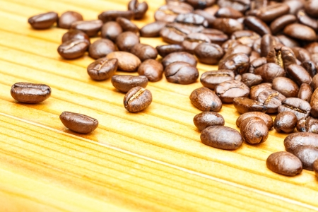 crop margin: close up of coffee beans on wooden table Stock Photo