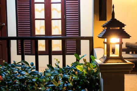 Lamp on porch in modern house at night , Chiangrai ,Thailand photo