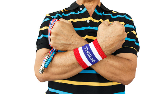 man hold whistle and wear wristband photo