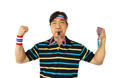 disharmony: Thai man hold whistle ,blow a whistle and wear wristband on white background