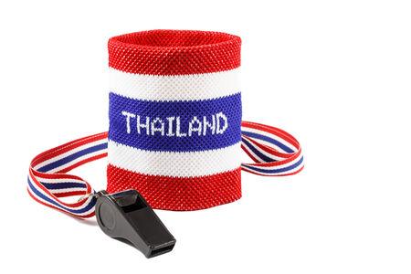 disharmony: Whistle and wristband in thai flag pattern on white background Stock Photo