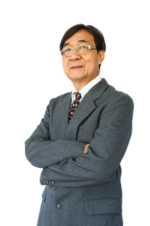grizzle: old aged thai businessman with glasses is standing and looking on white background isolated  Stock Photo