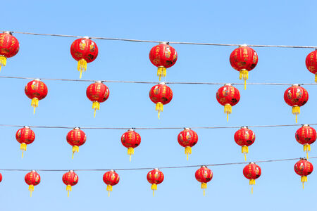 Chinese lamp on blue sky at chinese new year in Thailand photo