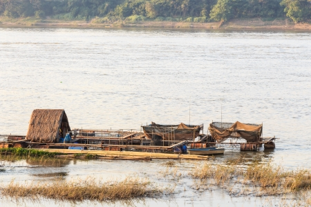 native houseboat on Mekong river in the evening at Chiang Khan ,Loei ,Thailand photo