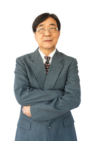 old aged thai businessman with glasses is standing and looking on white  photo