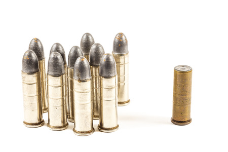 disintegrate: Think different  group of bullets and single bullet on white background