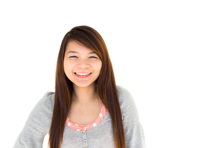 round face: round face and white skin thai hairy woman with gray coat is smiling