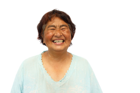 chuckle: Old aged thai woman is smiling and blank area at right side Stock Photo