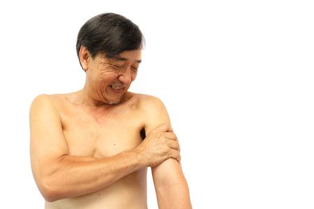 grasp: Old aged thai man grasp his arm.  Stock Photo