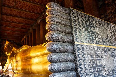 Reclining Buddha at Wat Pho (Wat Phrachettuphon),(Temple of Reclining Buddha) ,Bangkok ,Thailand photo