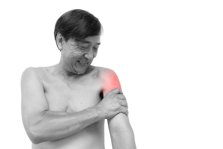muscle spasm: \\\\\\\Muscle strain\\\\\\\  Old aged thai man grasp his arm. And blank area at right side