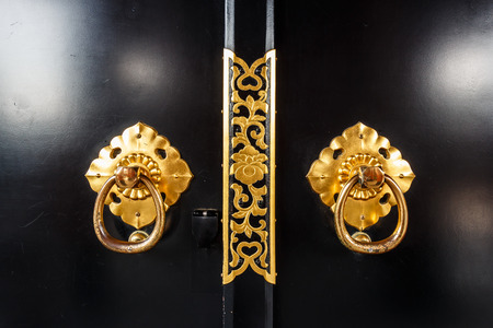 door handles: close up of door in asakusa temple with flower pattern at Tokyo , Japan Stock Photo