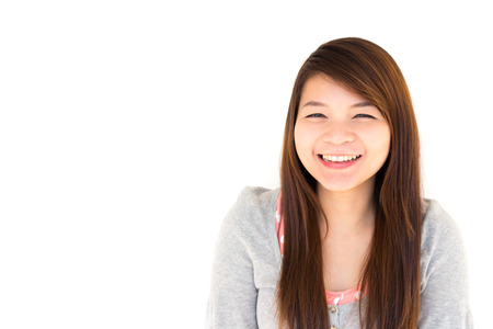round face: round face and white skin thai hairy woman with gray coat is smiling on white background