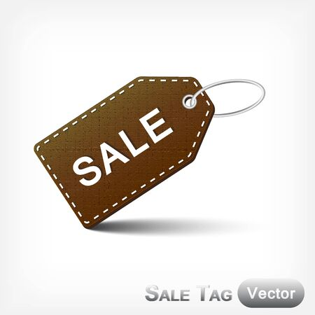 leather goods: Leather sale tag with metal loop on white background