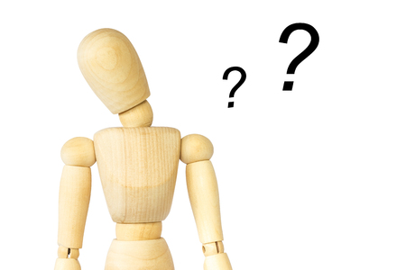 Wooden puppet tilt neck and doubt . Isolated background . Blank area at left side for fill your text . Stock Photo