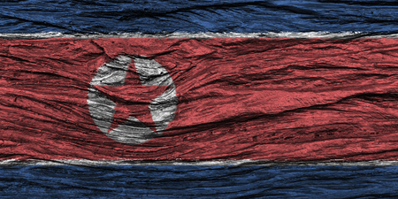 North korea flag with high detail of old wooden background . 3D illustration . Stock Photo