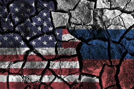 America and Russia flag on cracked ground . Confliction and crisis concept .