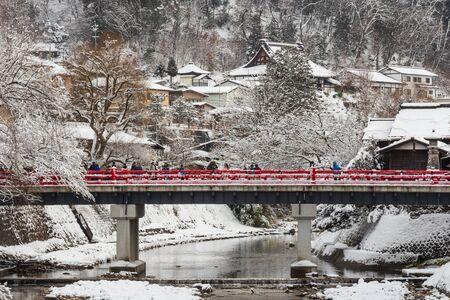 TAKAYAMA , JAPAN - January 29, 2019 : Nakabashi Bridge with snow fall and Miyakawa river and tourist in winter season . Landmark of Hida - Gifu - Takayama , Japan . Landscape view . 報道画像