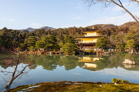 Kinkakuji Temple ( Rokuon-ji Temple ) ( Golden Pavilion ) at Kyoto , Japan . Landscape view . Editorial