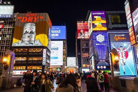 OSAKA , JAPAN - January 31, 2019 : Minami Namba and Shinsaibashi . Dotonbori area with many advertisement billboard on building such as Glico running man sign at night time .