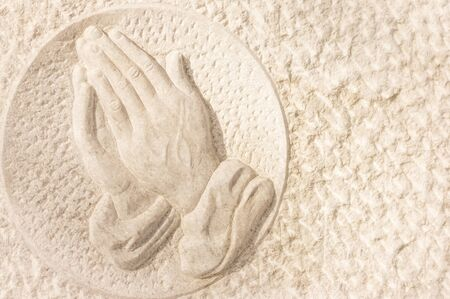 pratice: stone relief showing praying hands Stock Photo