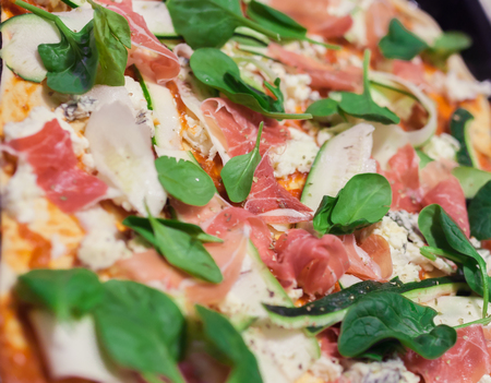 Closeup of spinach with meat and zucchini on pizza Stock Photo