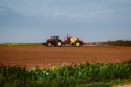 tractor working in field agriculture Stok Fotoğraf