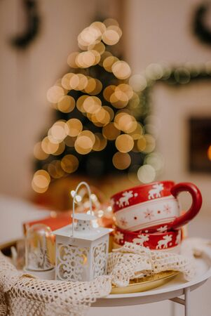 Christmas or new year decoration on white modern coffee table. Living room interior and holiday home decor concept. Stock Photo