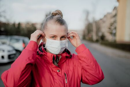 Portrait of Woman Wearing Protective Mask Against Covid-19 Outdoors Foto de archivo