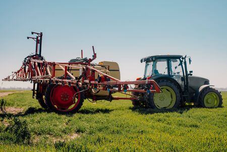 View of Tractor Ready to Spraying Herbicides. Foto de archivo