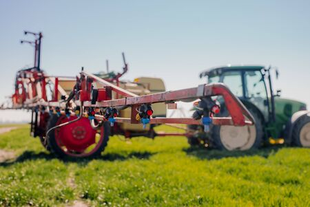 View of Tractor Ready to Spraying Herbicides. Фото со стока