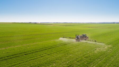 Tractor Spraying Herbicides on Field Agriculture