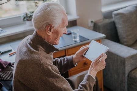 Positive Senior using Digital Tablet