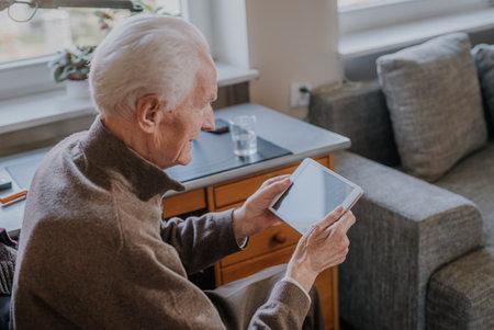 Cheerful Old man using Digital Tablet