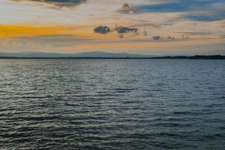Beautiful Sunset at Lake. Water Landscape at Sunset