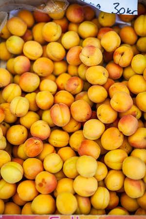 fresh ripe yellow peaches in a box