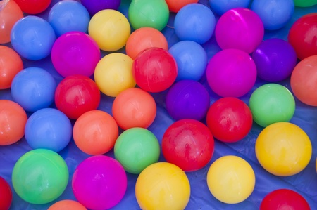 Toys for children with multi-colored plastic balls.