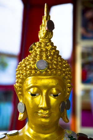 Buddha face consisting of the coin.