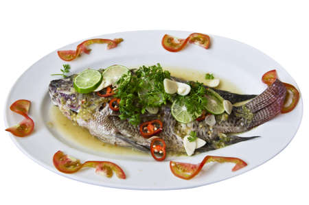 Freshwater fish steamed with lemon and sauce.