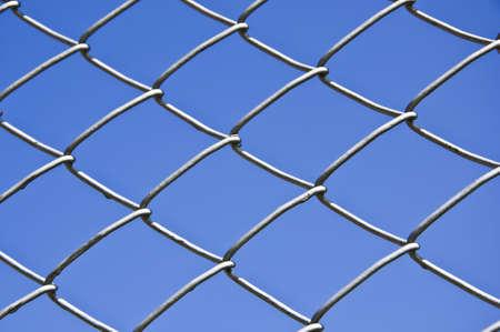 The iron fence on blue sky background. photo