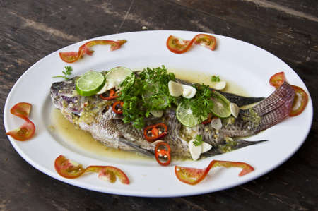 Freshwater fish steamed with lemon and sauce. photo