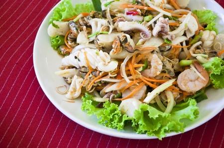 Thai style salad seafood on red back ground